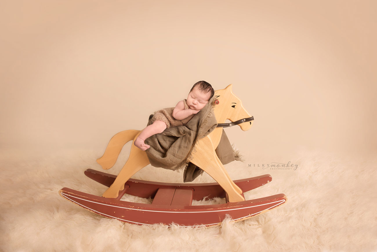 maryland-newborn-photographer-baby-on-rocking-horse-milky-monkey-photography